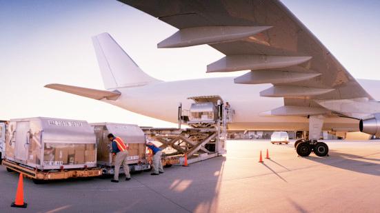 Loading aeroplane with cargo, dusk